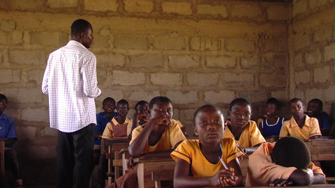 Teacher in a classroom talking to students, in Africa Footage
