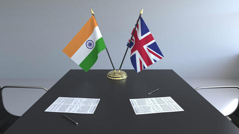 Flags of India and Great Britain and papers on the table. Negotiations and Live Action