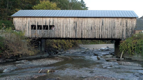 Aerial Drone - Stream Runs Under Weathered Covered Bridge in Fall in Vermont Live Action