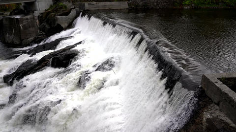 Water Rushes Over Small Hydro Electric Dam 4K Live Action