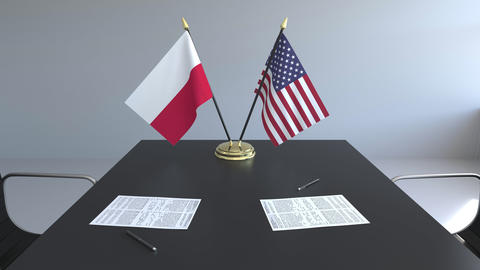 Flags of Poland and the United States of America and papers on the table Footage