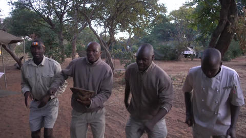 Camp staff sings when guests return from game drive in Botswana Footage