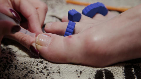 Caring about the girl legs pedicure, polish, beautiful lights. Pedicures in the Live Action