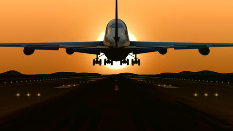Airplane landing at orange sunset GIF