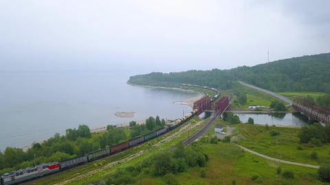 Trans-Siberian Railway, the coast of Lake Baikal. Movement of trains on the iron Footage
