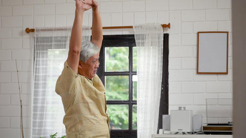 Portrait asian senior man exercise in living room at home Footage