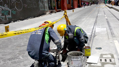 Cuenca, Ecuador - 20180920 - Worker Applies Glue To Panel He Is About To In Footage
