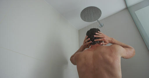 Man Washing Hair While Taking Shower At Bathroom In Home Showering Footage