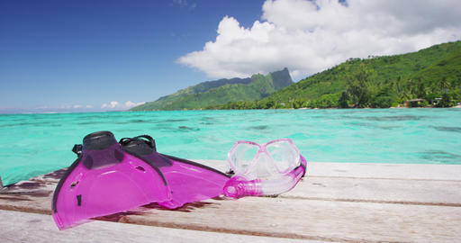 Travel vacation getaway - Woman Wearing Diving Fins Sitting On Jetty on Vacation Live Action