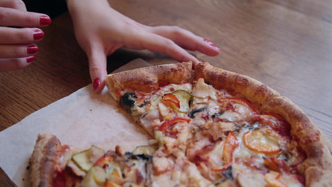 Close-up Of People Hands Taking Slices Pizza. Frame. Takes eating a slice of Live Action