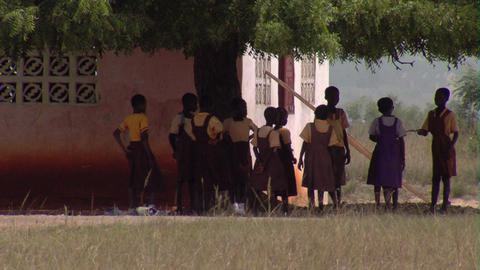 Students outside of a building in Africa Footage
