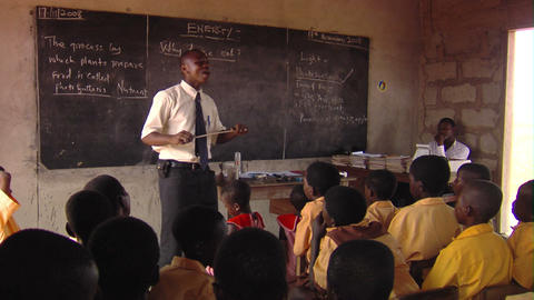 A man teaching students in Africa Footage