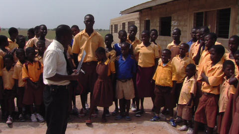 Teacher talking to students outside in Africa Footage