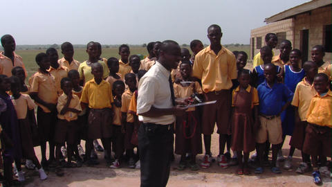 A teacher and students outside in Africa Footage