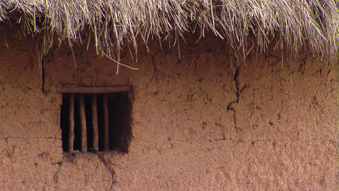 Window of a grass and mud hut in Africa Footage