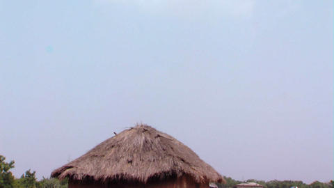 Grassy hut and the sky in Africa Footage