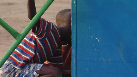 Children on a merry go round in Africa Footage