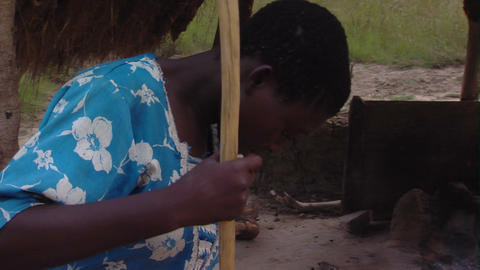 A woman sweeping the ground in Africa Footage