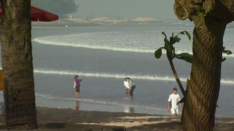 Far shot of a beach through trees in Bali Footage