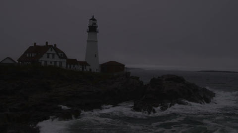 Waves breaking on the shore by the Portland Head Light in Maine Footage