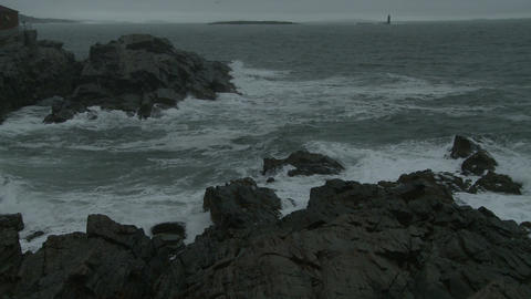 Waves breaking on an outcropping of rocks on the coast of Maine Footage