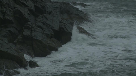 Close-up of waves crashing on a rocky outcropping in Maine Footage