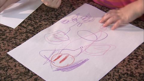 Royalty Free Stock Footage of Child drawing a picture with crayons Footage