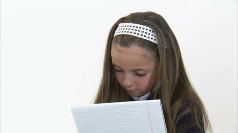 Royalty Free Stock Footage of Young girl doing homework gets an idea Footage