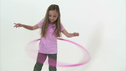 Royalty Free Stock Footage of Young girl hula hooping on white Footage