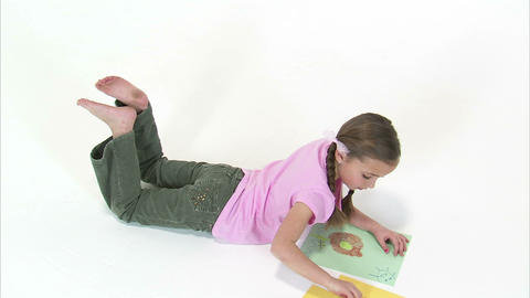 Royalty Free Stock Footage of Young girl drawing a picture with crayons Footage