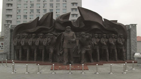 "Shot of a statue of soldiers labeled ""For Peace"" in China Footage"