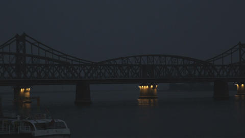 Panning shot of two suspension bridges in China Footage