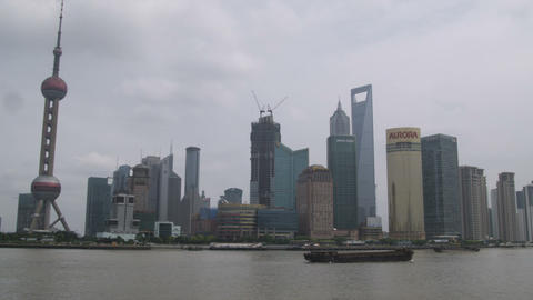 Shanghai cityscape from arcrost the river on an overcast day Footage
