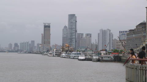 Clip of people standing at a pier in Shanghai China Footage