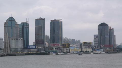Skyscrapers with huge company logos alongside Huangpu Footage