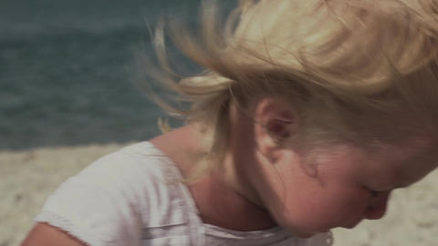 Crying little girl by the sea. Little girl with tears in her eyes Footage