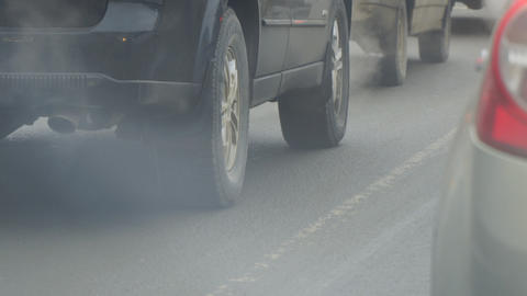 Cars in traffic. Exhaust fumes from exhaust pipe Live Action