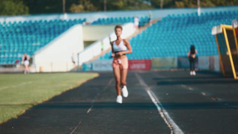 The young girl regularly sports. During this it runs... Stock Video Footage
