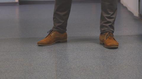 Feet men in brown shoes ビデオ