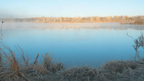 Morning fog on the lake in the frosty morning Stock Video Footage