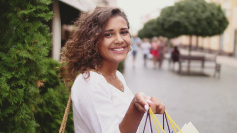 Woman in shopping. Happy woman with shopping bags enjoying in shopping Footage