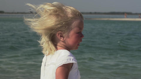 Crying little girl by the sea. Little girl with tears in her eyes Live Action