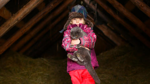 Little girl playing with a cat in winter Stock Video Footage