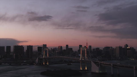 Cityscape of Tokyo and the landscape of Tokyo Bay at dusk - Zoom out Footage