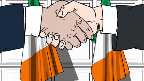 Businessmen or politicians shake hands against flags of Ireland. Official Footage