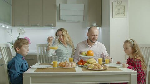 Happy family having healthy breakfast in kitchen Footage
