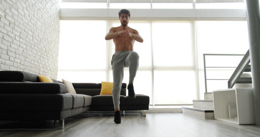 Caucasian Man Training At Home For Wellness Wellbeing Fitness Sport Live Action