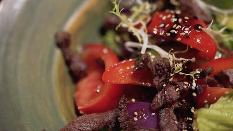 Close up of salad ingredients are in the plate. Healthy food with sesame on the Live Action