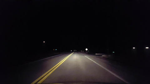 Driving Rural Countryside Road Into the City at Night. Driver Point of View POV Footage