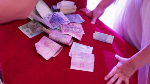 Counting money on banket Footage